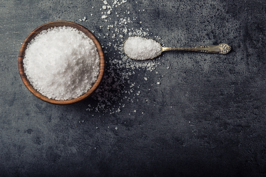 Salt. Coarse grained sea salt on granite - concrete stone backg